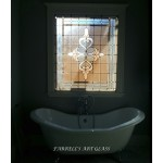 Stained glass window and a claw-footed bathtub by Farrell's Art Glass