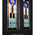 Stained glass window by Farrell's Art Glass with arrows
