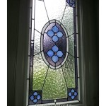 Stained glass window by Farrell's Art Glass with blue flowers