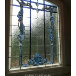 Stained glass window by Farrell's Art Glass with blue ribbon work